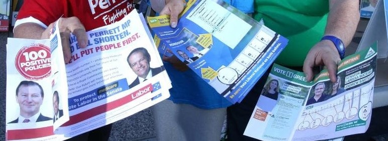 Handing Out How To Vote Cards